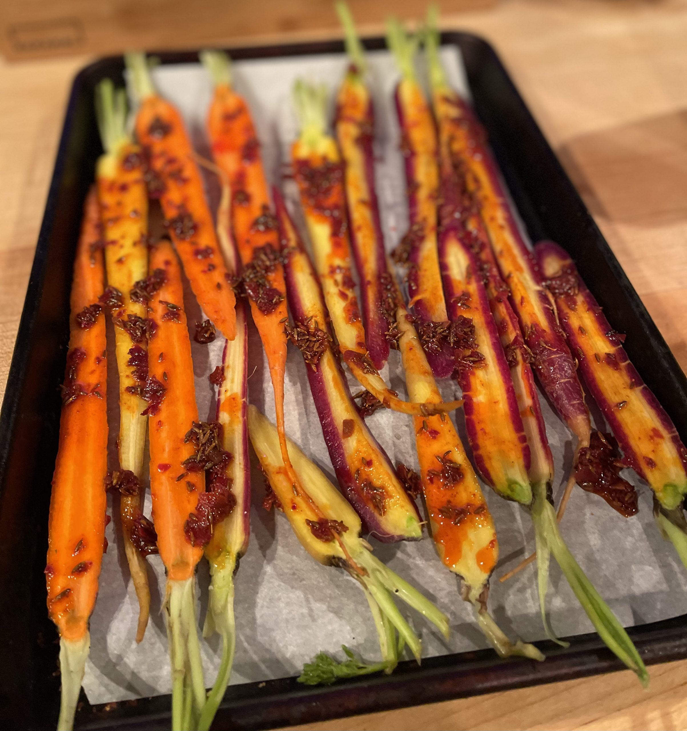 Carrots Roasted with Rose Harissa and drizzled with Garlic Tahini Sauce